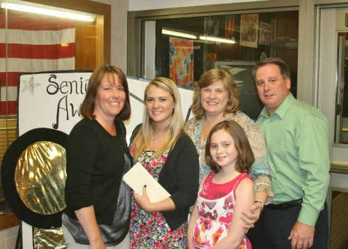 Nancy Orlando with Kelly Carroll and her family.
